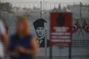 The Latest: Erdogan tells Putin about Syria incursion plans